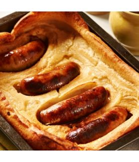Toad In The Hole - Four juicy Lincolnshire sausages in a tray of crispy batter, the essence of British comfort food.