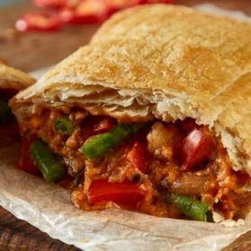 Red Thai Slice - Our delicious Vegan Thai Curry Slice, a warm vegetable filling encased in puff pastry!