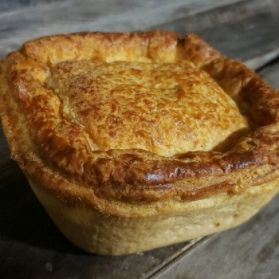 Whole cheese and onion pie with puff pastry lid